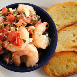 Greek Shrimp Bruschetta - Perfect for a party! Sauteed shrimp with olives, tomato, feta and capers. Serve with crunchy bruschetta. | foxeslovelemons.com
