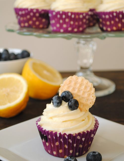 Blueberry Cupcakes with Lemon Cream Cheese Frosting - Lemon-flecked Greek yogurt blueberry cupcakes with lemon cream cheese frosting. | foxeslovelemons.com