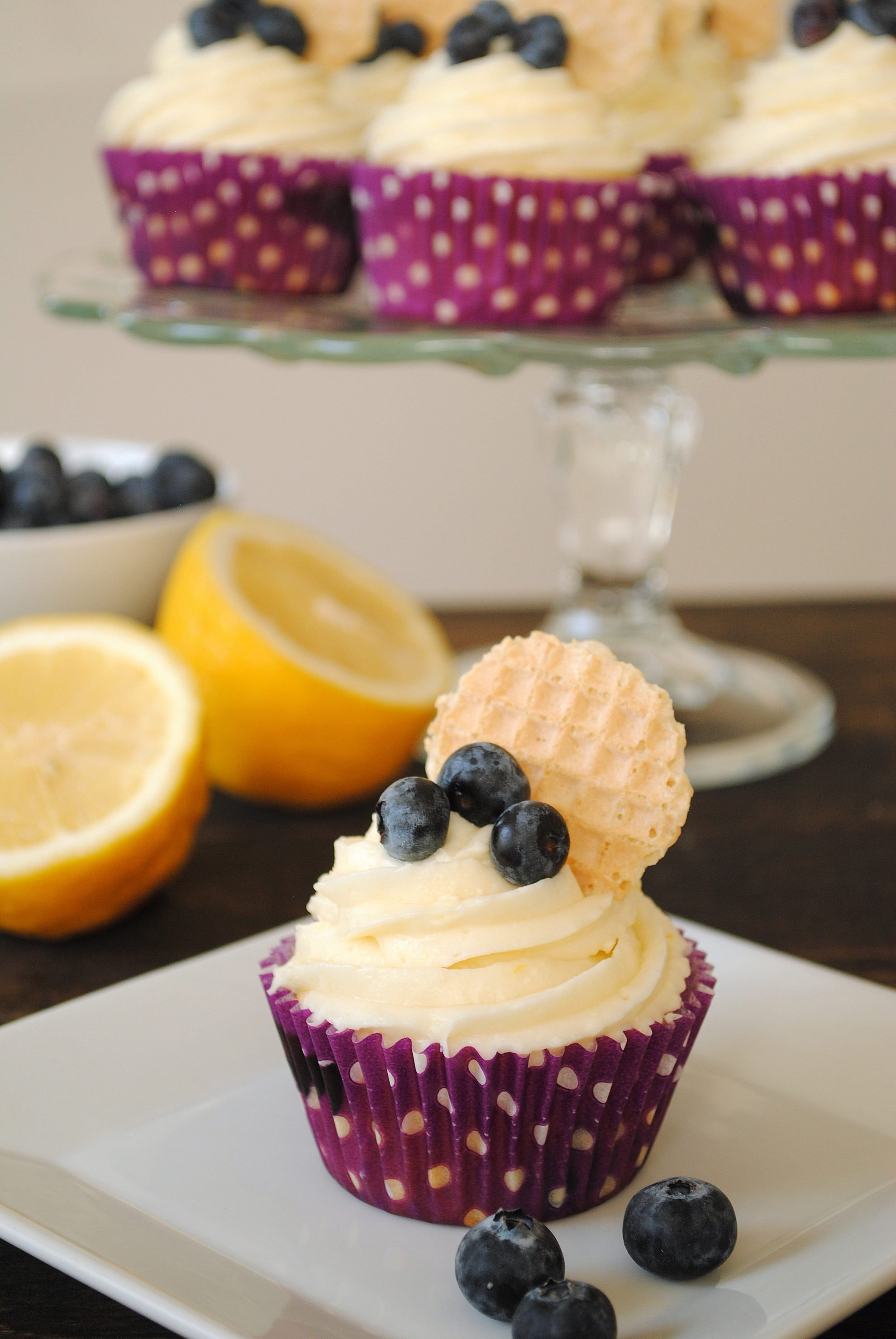Blueberry Cupcakes with Lemon Cream Cheese Frosting - Lemon-flecked Greek yogurt blueberry cupcakes with lemon cream cheese frosting. | foxeslovelemons.com