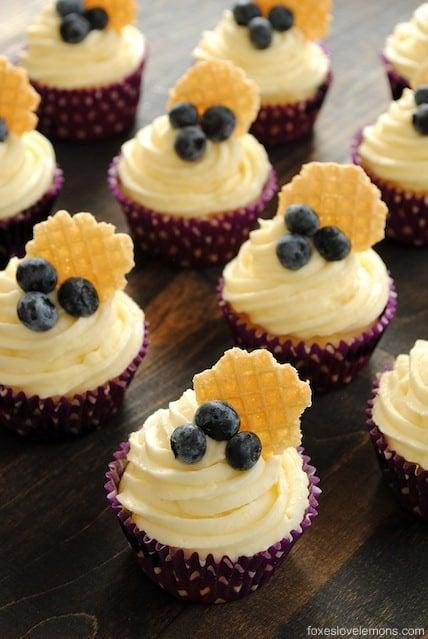 Blueberry Cupcakes with Lemon Cream Cheese Frosting - Lemon-flecked Greek yogurt blueberry cupcakes with lemon cream cheese frosting.   foxeslovelemons.com
