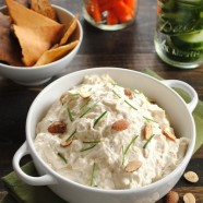 Roasted Garlic and Almond Dip - A creamy yet healthy dip made with Greek yogurt, roasted garlic, Parmesan cheese and crunchy almonds. Perfect to take to a party, pack in your lunch, or spread on a sandwich or burger.   foxeslovelemons.com
