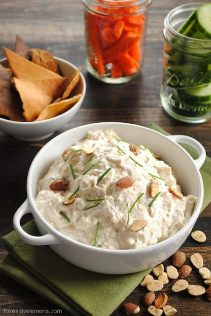 Roasted Garlic and Almond Dip - A creamy yet healthy dip made with Greek yogurt, roasted garlic, Parmesan cheese and crunchy almonds. Perfect to take to a party, pack in your lunch, or spread on a sandwich or burger.