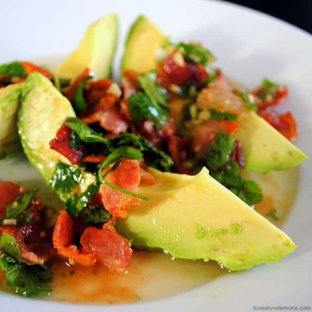 Avocado with Warm Bacon Dressing – fresh ripe avocado topped with a warm dressing made from bacon, lime juice, shallot, sriracha and parsley.
