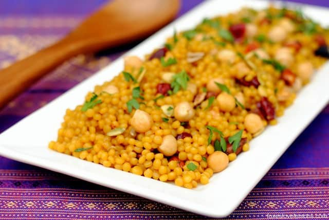 Curried Cranberry Couscous Pilaf – an easy yet elegant side dish of Israeli couscous tossed with chickpeas, dried fruit and nuts.
