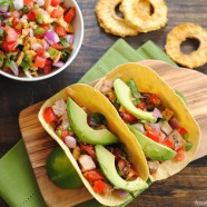 Grilled Pork Tacos with Pineapple Salsa - slightly spicy grilled pork with a sweet and savory pineapple salsa. The perfect summer meal! | foxeslovelemons.com
