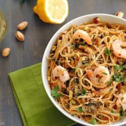 Lemon Shrimp & Caper Linguine - A fresh, light whole wheat linguine dish with sauteed shrimp, capers, garlic, olive oil, lemon juice, parsley, red pepper flakes, parmesan and pistachios. | foxeslovelemons.com