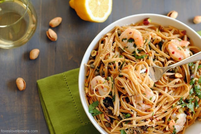Lemon Shrimp & Caper Linguine - A fresh, light whole wheat linguine dish with sauteed shrimp, capers, garlic, olive oil, lemon juice, parsley, red pepper flakes, parmesan and pistachios.