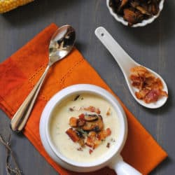 "Sweet Corn & Wild Mushroom Soup - A creamy summer soup celebrating the season's sweet corn. Topped with crispy bacon and seared wild mushrooms. From Michael Symon's ""Live To Cook"" cookbook. 