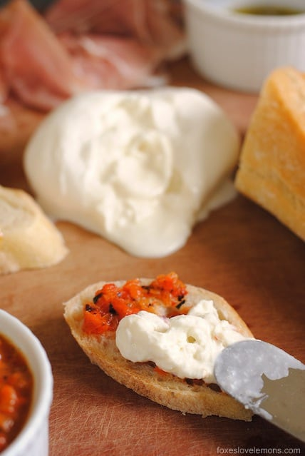 Burrata with Grilled Red Pepper Dip – the perfect cheese board for a party, or as a simple dinner. | foxeslovelemons.com