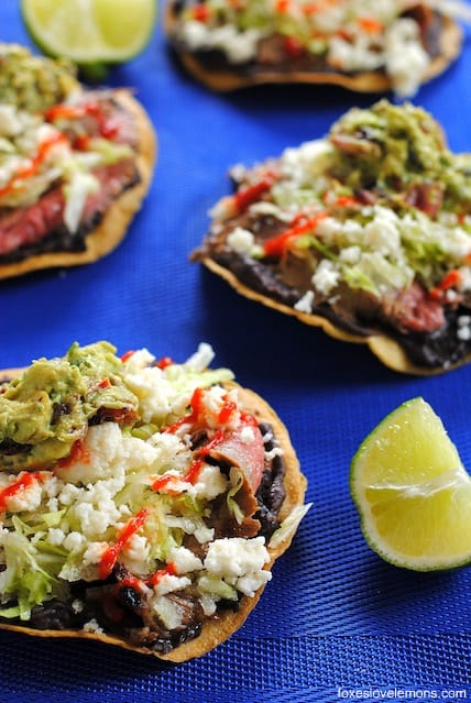 Flank Steak Tostadas – a quick and easy weeknight meal featuring grilled flank steak, black beans and queso fresco. | foxeslovelemons.com