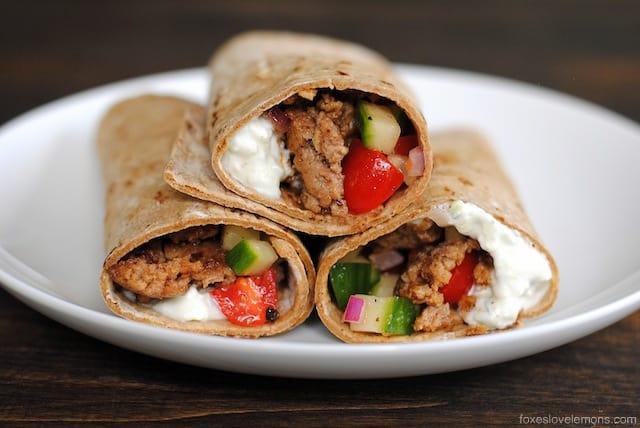 Greek Taco Wraps - seasoned ground lamb wrapped up with a Greek yogurt tzatziki and tomato-cucumber relish. | foxeslovelemons.com