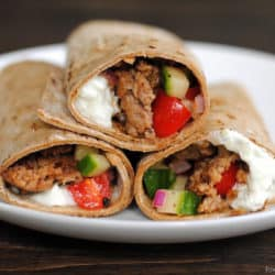 Greek Taco Wraps - seasoned ground lamb wrapped up with a Greek yogurt tzatziki and tomato-cucumber relish. | foxeslovelemons.com