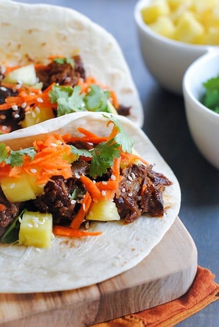 Asian Short Rib Tacos with Pineapple and Crunchy Slaw - a tasty meal where your slow cooker does all the work!