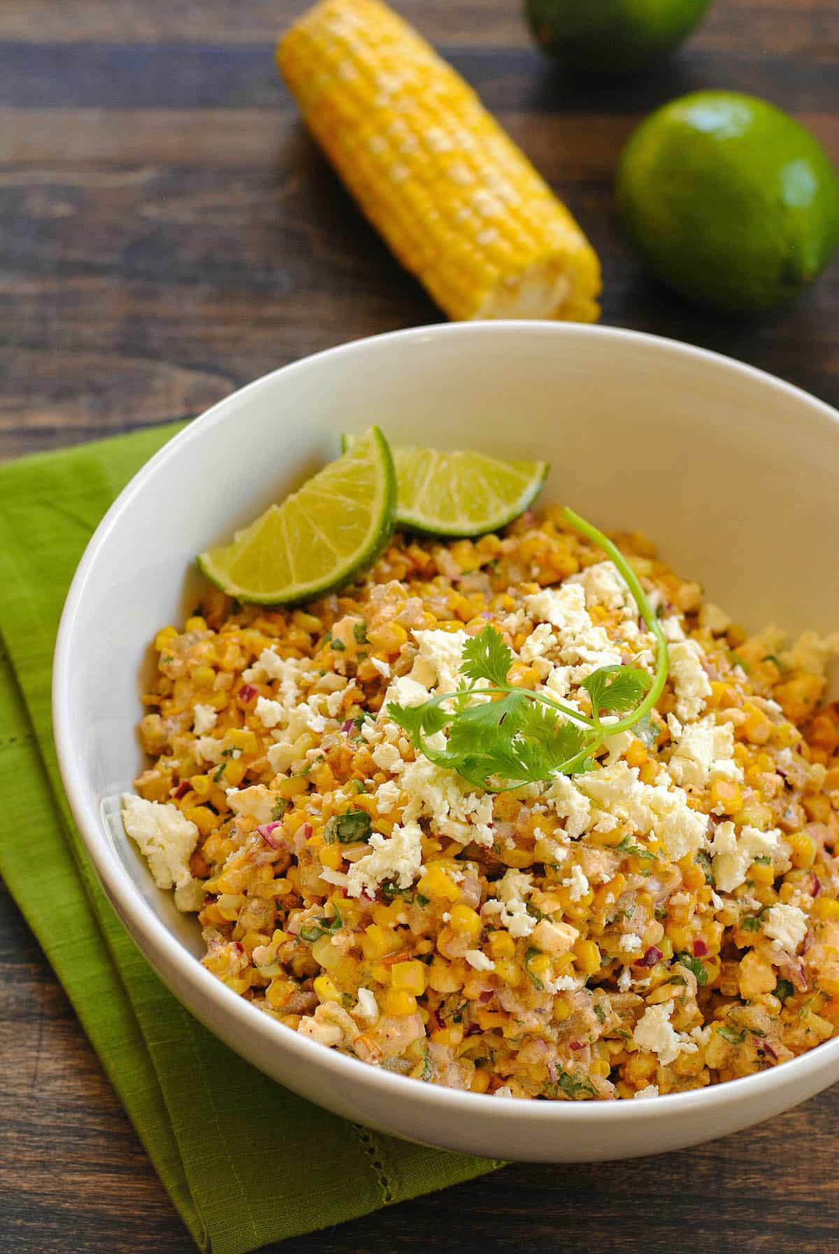 Inspired by Mexican roasted street corn (elote), this Mexican Roasted Corn Salad has a bright and creamy flavor that is always a crowd pleaser. Can be served chilled or at room temperature. | foxeslovelemons.com