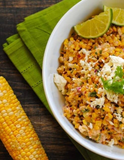Roasted Mexican Street Corn Salad - A crunchy and spicy salad with just a bit of creaminess. Can be served warm or cold.   foxeslovelemons.com