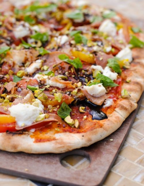 Rustic Italian Farmhouse Pizza - a complete meal on a pizza. Includes prosciutto, ricotta, roasted yellow peppers, basil, pistachios and balsamic vinegar.   foxeslovelemons.com