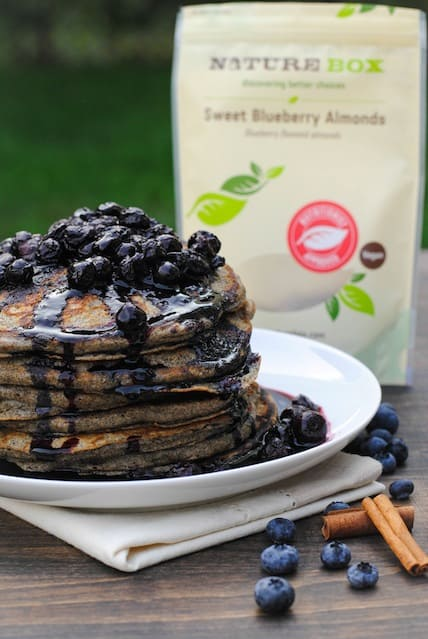 Blueberry Almond Pancakes with Blueberry-Cinnamon Sauce - a healthful and tasty breakfast made with nuts, fruit and whole-grain flour.   foxeslovelemons.com