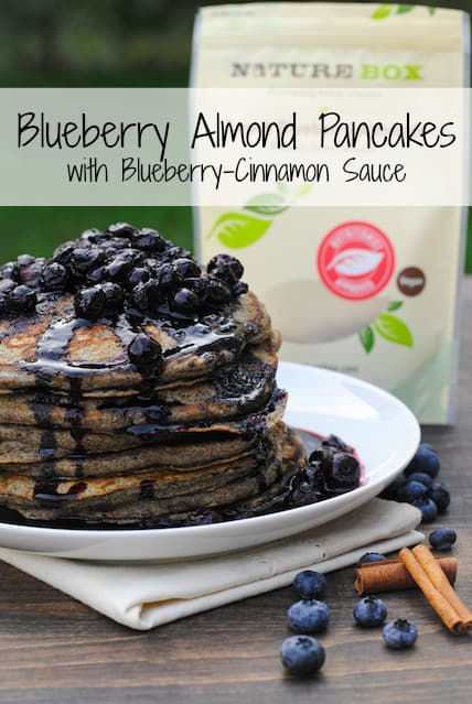 Blueberry Almond Pancakes with Blueberry-Cinnamon Sauce - a healthful and tasty breakfast packed with nuts, fruit and whole-grain flour.