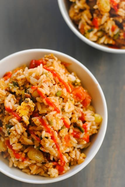 Picadillo Fried Rice - a quick Cuban-inspired stir-fry using leftover picadillo and roasted poblano pepper.   foxeslovelemons.com