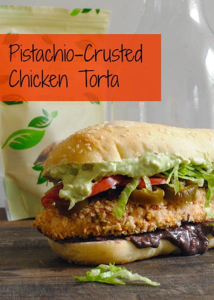 Pistachio-Crusted Chicken Tortas - Crispy baked chicken breasts topped with mashed black beans, jalapenos, lettuce, tomato and creamy avocado sauce. | foxeslovelemons.com