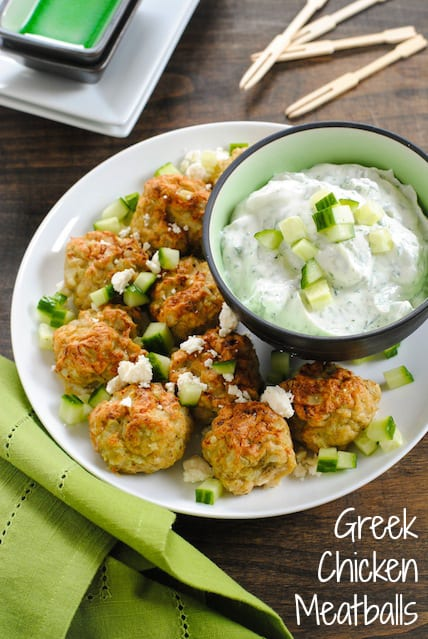 Greek Chicken Meatballs with Herbed Yogurt Sauce - Perfect for New Year's Eve! Can be kept warm in a slow cooker! | foxeslovelemons.com