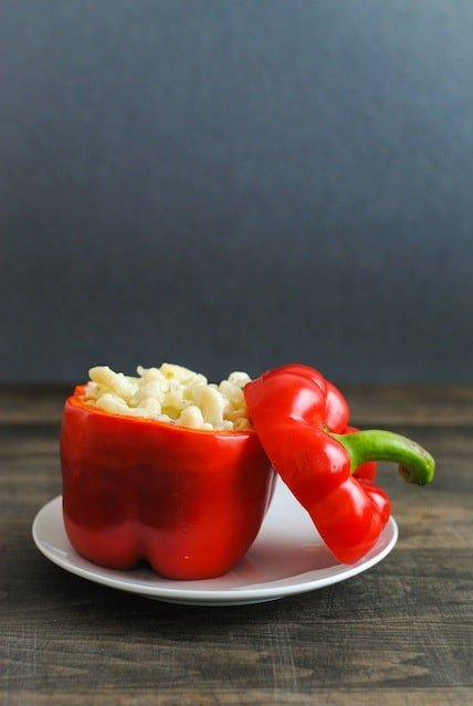 Italian Mac & Cheese Stuffed Peppers - Creamy pasta with lots of cheese and herbs stuffed into red peppers and roasted.