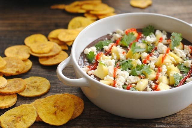Sweet and Spicy Black Bean Dip with Plantain Chips - creamy mashed black beans topped with queso fresco and juicy pineapple