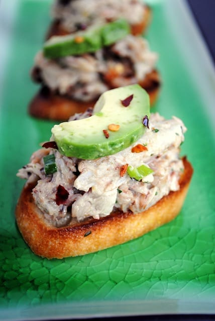 Crabby Snacks - Perfect for New Year's Eve! Crunchy bruschetta topped with fresh crab salad and creamy avocado.  | foxeslovelemons.com