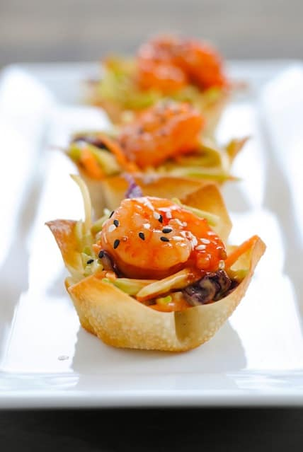 Asian Shrimp Wonton Cups - Crunchy wonton cups filled with broccoli slaw and topped with sweet chili glazed shrimp. Special yet incredibly simple!
