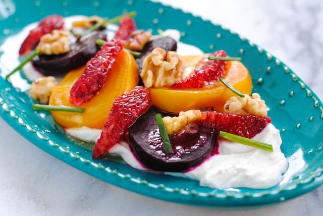 Beet, Blood Orange & Chevre Salad - Roasted beets, blood orange segments, walnuts, chives, chevre cream and white wine vinaigrette. A beautiful, heart-healthy and delicious salad!   foxeslovelemons.com