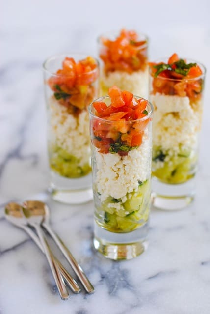 Feta Salad Shooters - layers of crunchy cucumber, tangy feta cheese, and fresh tomato and basil. A perfect, simple party bite for the summer!   foxeslovelemons.com