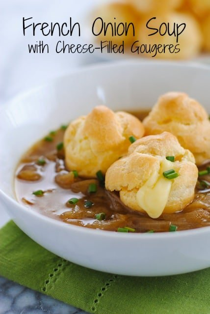 French Onion Soup with Cheese-Filled Gougeres - Classic French Onion Soup topped with little cream puffs filled with gloriously melty cheese.