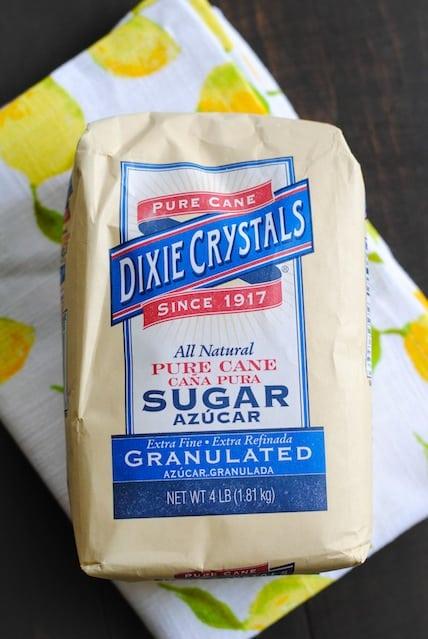 Meyer Lemon Bars with Poppyseed Crust - A flaky poppyseed crust topped with tart and sweet Meyer lemon filling. | foxeslovelemons.com