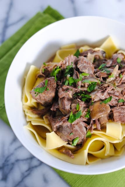 Slow Cooker Beef Stroganoff - Rich and creamy beef and mushroom stroganoff with egg noodles. Let your crock pot do all the work!