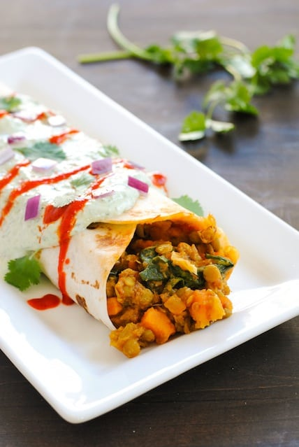 The Big Ol' Lentil Burrito - A meatless but filling burrito filled with lentils and sweet potatoes, and topped with a creamy yogurt sauce. | foxeslovelemons.com