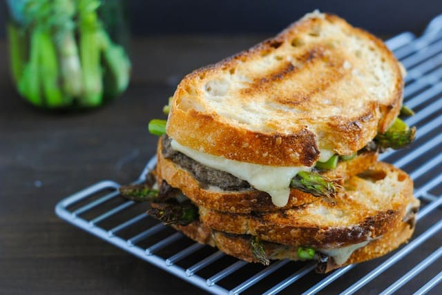 Mushroom & Asparagus Grilled Cheese - Crusty bread filled with a sautéed mushroom mixture, roasted asparagus and Gruyere cheese.   foxeslovelemons.com