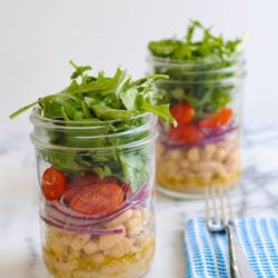 White Bean Salad Jars - A light and fresh lunch to get you through the work week. Layers of marinated cannellini beans, grape tomatoes, red onion and peppery arugula. | foxeslovelemons.com