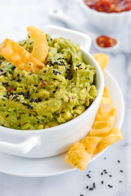 Asian Sesame Guacamole - A fun Asian-inspired twist on classic guacamole. Serve with crunchy wonton strips for a unique party dip! | foxeslovelemons.com