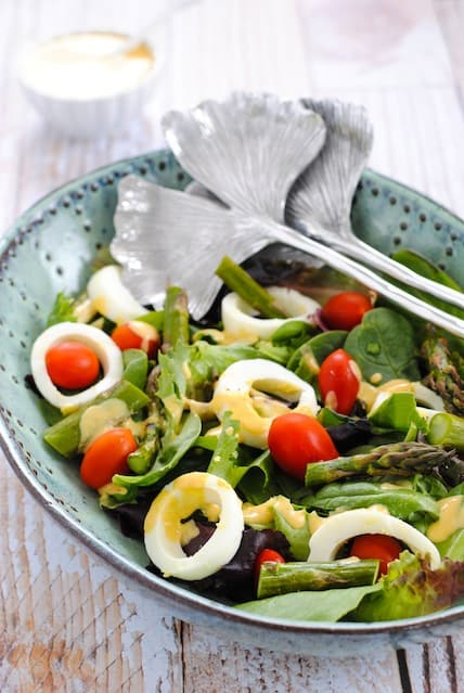 Spring Salad with Deviled Egg Vinaigrette - A fresh and healthy spring salad with a creamy vinaigrette that tastes like deviled eggs!   foxeslovelemons.com