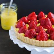 Strawberry Tart with Moscato Lemon Curd - An elegant and beautiful summer dessert that tastes like strawberry lemonade with a hint of moscato wine! | foxeslovelemons.com
