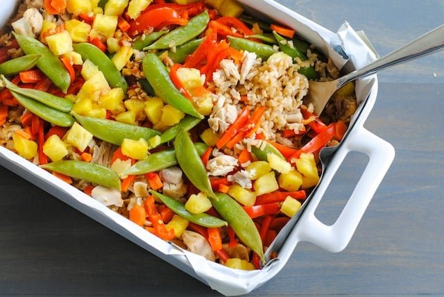 Sweet and Sour Chicken Stir-Fry Casserole - An Asian-inspired chicken and rice casserole that is loaded with veggies! A breeze to prepare and clean up.   foxeslovelemons.com