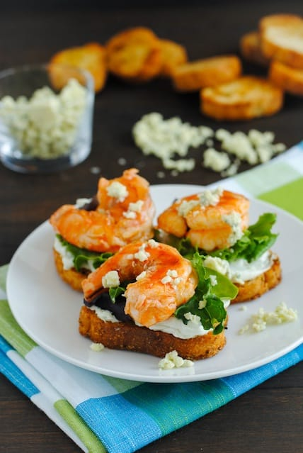 Buffalo Shrimp Crostini with Blue Cheese Spread - A crowd-pleasing party bite that's a breeze to prepare! | foxeslovelemons.com