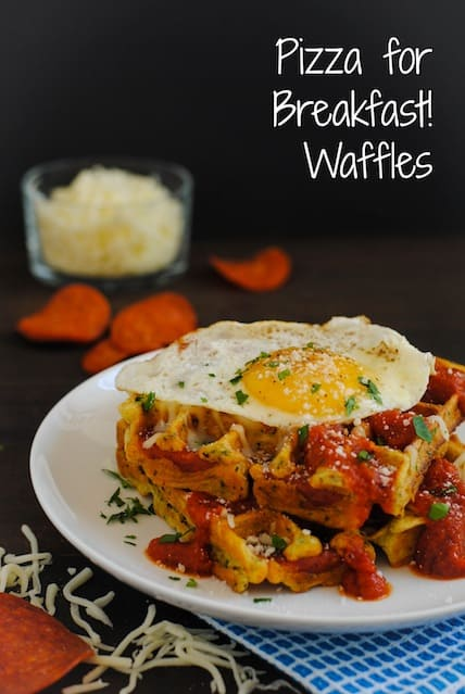 Pizza for Breakfast! Waffles - Savory waffles studded with pepperoni, topped with pizza sauce, mozzarella cheese and a sunny side up egg!   foxeslovelemons.com