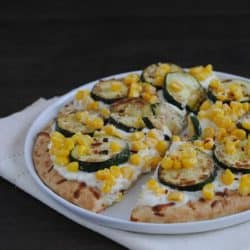 Zucchini & Corn Mini Pizzas - A family-friendly meal that highlights the season's best produce! | foxeslovelemons.com
