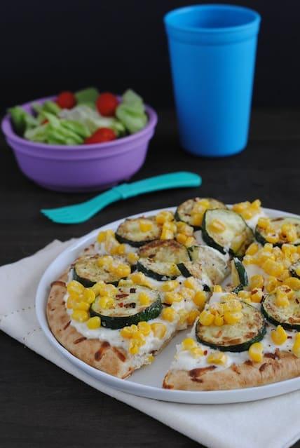 Zucchini & Corn Mini Pizzas - A family-friendly meal that highlights the season's best produce! | foxeslovelemons.com
