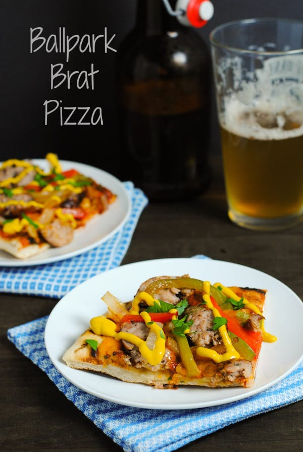 Ballpark Brat Pizza - Bring your favorite ballpark food home with this grilled pizza topped with bratwurst, sauteed peppers and onions, smoked cheddar cheese and mustard! | foxeslovelemons.com