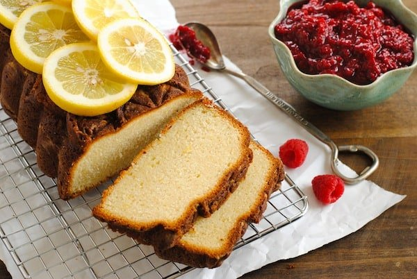 Lemon Pound Cake with Raspberry Compote - A stunning pound cake with a triple shot of lemon flavor, served with a quick raspberry sauce. | foxeslovelemons.com
