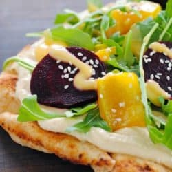 Clean Slate Flatbread - Whole wheat naan topped with hummus, roasted yellow peppers and beets, arugula, sesame seeds and honey mustard.   foxeslovelemons.com