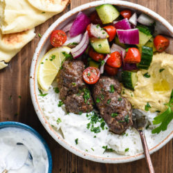 This Easy Kafta Recipe turns a classic Lebanese dish into a simple weeknight meal. This recipe uses ground beef, doesn't make you mess around with skewers, and can be served two different ways - as a sandwich or in a bowl! | foxeslovelemons.com