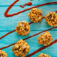 Peanut Butter-Sriracha Popcorn Balls - An easy, spicy and sweet treat made with popcorn, sriracha, peanut butter, ginger, peanuts and sesame seeds.   foxeslovelemons.com